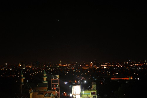 The star Arcturus above the cityscape.